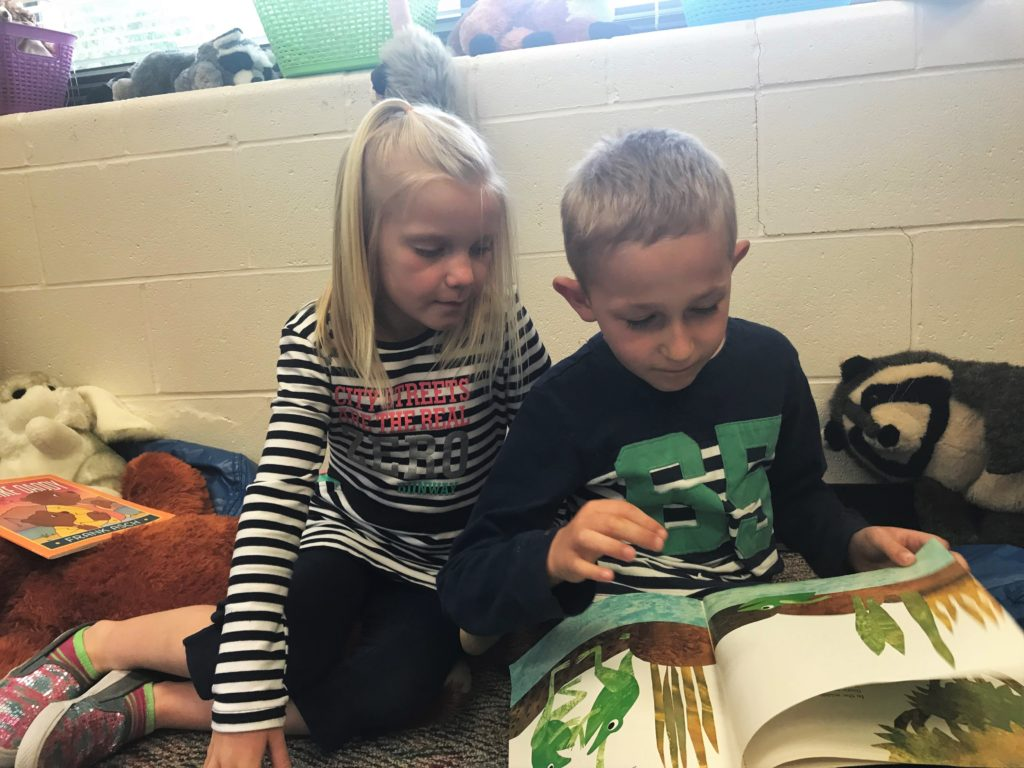 Weston (right) and a friend reading a book together.