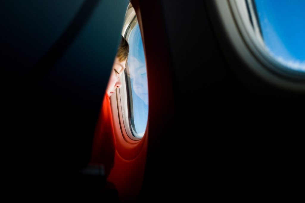 Child looking out of airplane